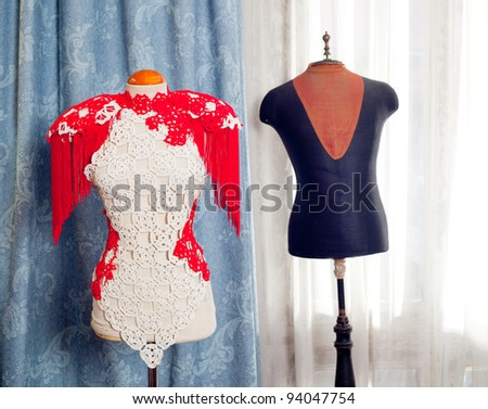 dressmakers and taylor mannequin with fashion clothes and curtain background - stock photo