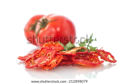 dried and fresh tomatoes on white background - stock photo