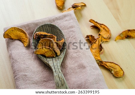 dried apples on a wooden table - stock photo