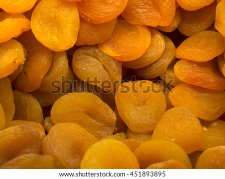Dried apricot fruit forming a background - stock photo