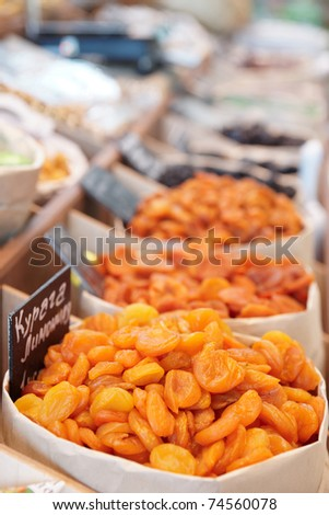 Dried apricots and another preserved food on street market - stock photo
