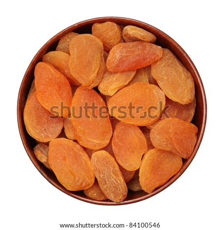Dried apricots in a bowl wooden - stock photo