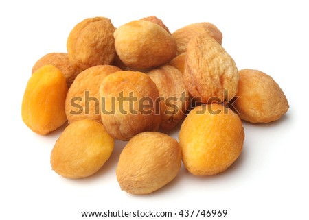 Dried apricots with bone on white background - stock photo