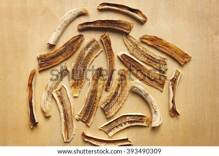dried banana (raw food sweet banana chips) on the wooden table