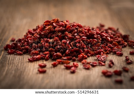 Dried Barberry (Berberis vulgaris) on wooden table