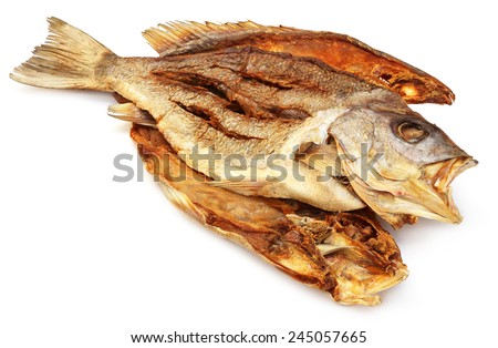 Dried Barramundi or Koral fish of Southeast Asia over white background - stock photo
