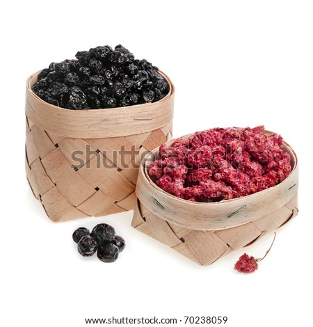 Dried berries : blueberry , raspberries and black currant on a white - stock photo