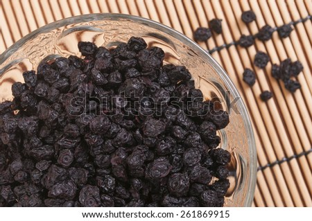 Dried blueberries in a glass bowl - stock photo