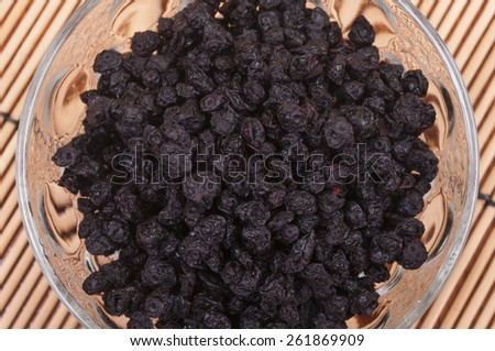 Dried blueberries in a glass bowl - aerial view - stock photo