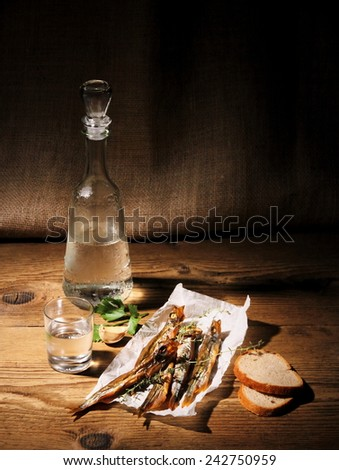 Dried capelin with glass of vodka and bread, vertical