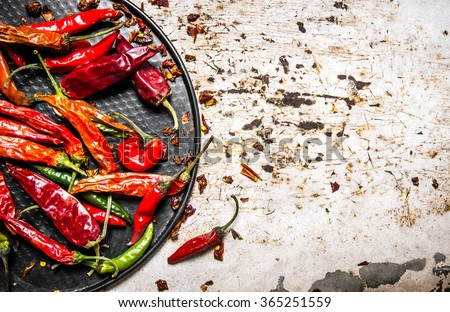 Dried chili pepper on the tray. On the rustic background. Free space for text . Top view - stock photo