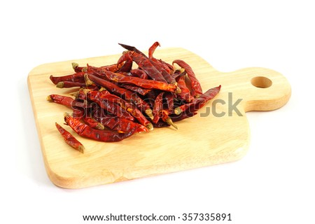 Dried chili peppers, isolated on white background. - stock photo