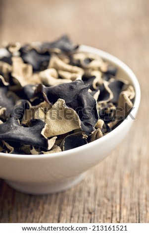 Dried chinese black fungus. Jelly ear in bowl. - stock photo