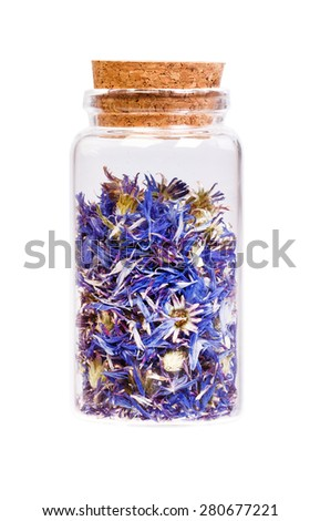 Dried cornflower tea in a bottle with cork stopper for medical use. - stock photo