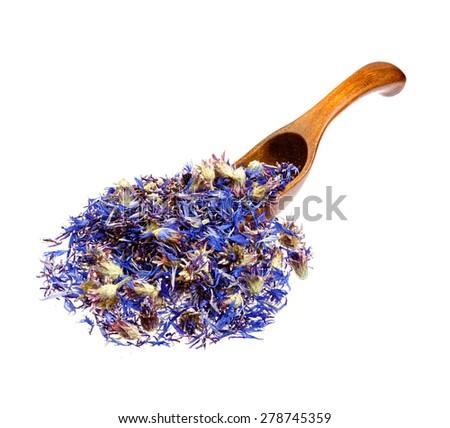 Dried cornflower tea on the wooden spoon. - stock photo