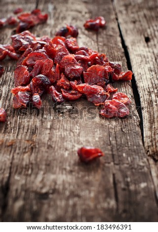 Dried Cranberries fruit on wooden background. Healthy food organic nutrition - stock photo
