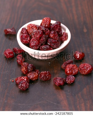 dried cranberries in a bowl.fruit full of vitamin c. - stock photo