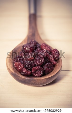 dried cranberries in a bowl.fruit full of vitamin c - stock photo