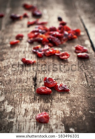 Dried Cranberries on wooden background. Healthy food organic nutrition - stock photo