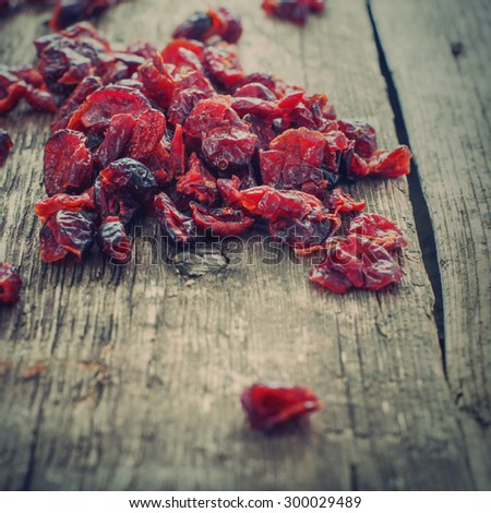 Dried Cranberries on Wooden Table. Healthy food organic nutrition. Toned - stock photo