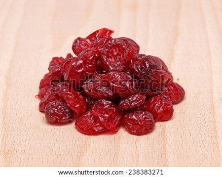 Dried cranberries (Vaccinium macrocarpon)  in wooden plate - stock photo