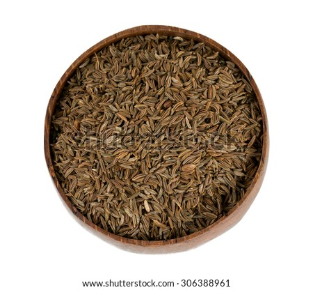 dried cumin in a wooden bowl
