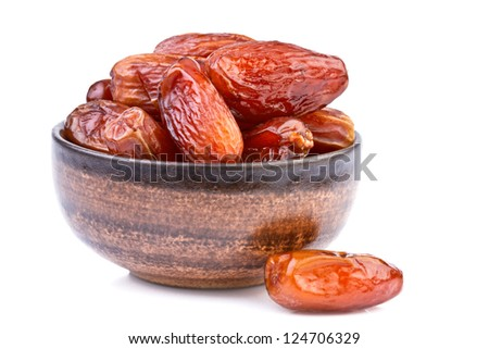 dried dates in brown cup isolated on white - stock photo