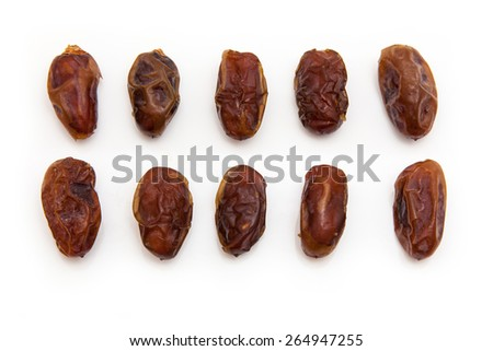 Dried  dates isolated on a white background - stock photo