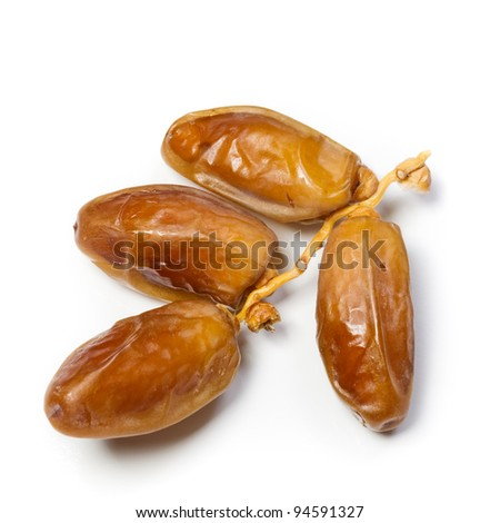 Dried dates on stalk, white background - stock photo