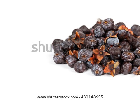 Dried Diospyros lotus or Wild Persimmon on white background. Selective focus. - stock photo