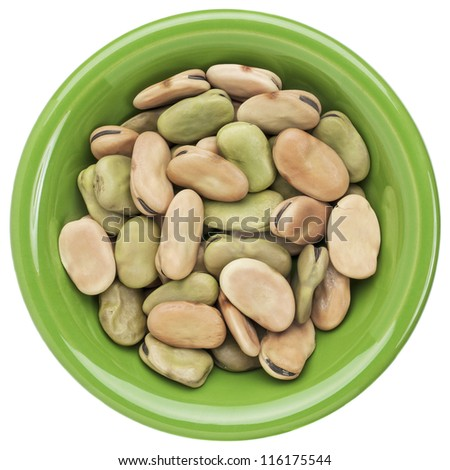 dried fava (broad) bean in a small ceramic bowl isolated on white