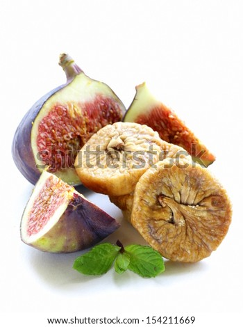 dried figs and fresh fruit on a white background - stock photo