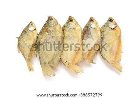 dried fish fillets skewers on a white background