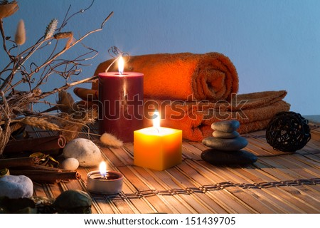 dried flowers, candles, cinnamon - chromoterapy - cyan orizzontal - stock photo