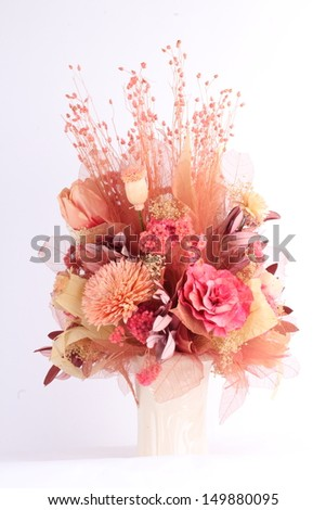 Dried flowers in a vase on a white background - stock photo