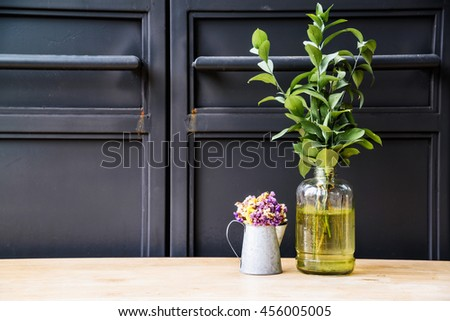 Dried flowers in a zinc bucket and plants vase decorations of the cafe. - stock photo