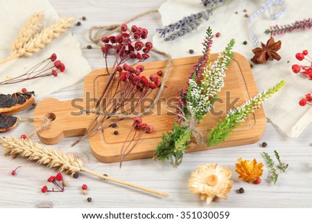 dried flowers on wooden background - stock photo