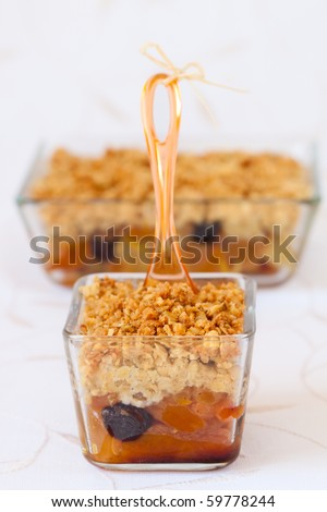 Dried fruit(apricots and raisins) crumble topping with granola and almond - stock photo
