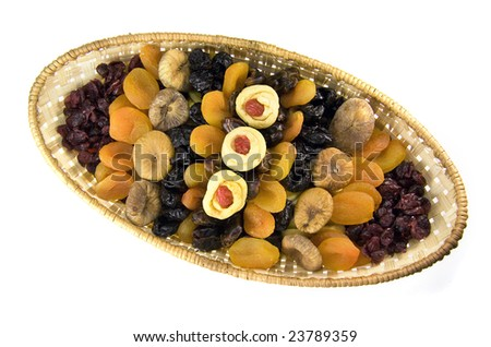 Dried fruit arranged in a basket - top view, ornaments made of apples - stock photo