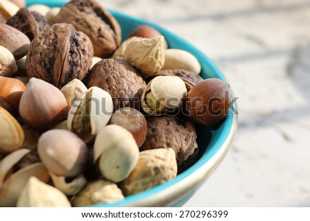 Dried fruit in a turquoise bowl  - stock photo