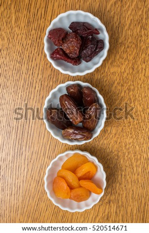 Dried fruit snacks in party bowls from above