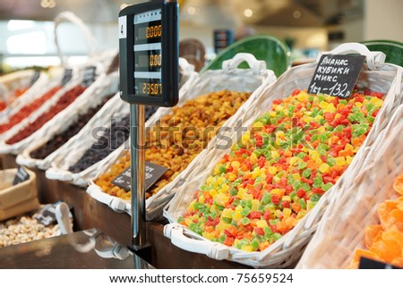 Dried fruits and another preserved food on market display - stock photo