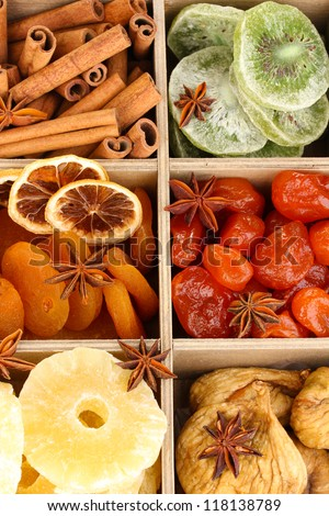 Dried fruits and cinnamon with anise stars in box close-up - stock photo