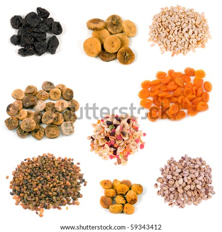 Dried fruits and nuts collection on the white background - stock photo