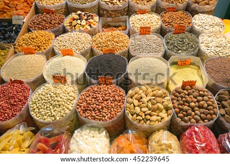 Dried Fruits and Nuts in Bulk Bags at Market - stock photo