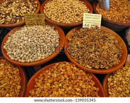 Dried fruits and nuts on the market. - stock photo