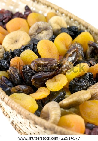 Dried fruits arranged in a basket - stock photo