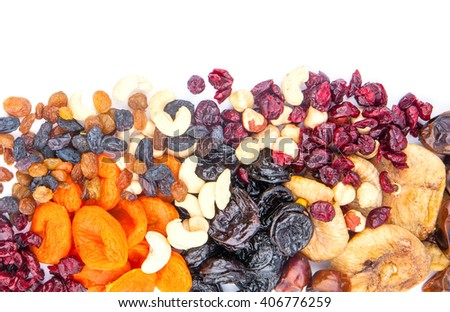 Dried fruits assortment on white background, health food concept. - stock photo