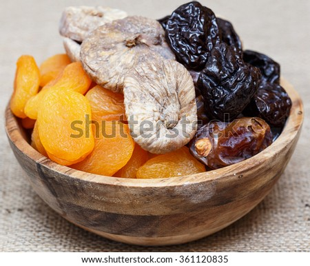 Dried fruits for Tu Bishvat holiday . Apricot, fig, palm and plum - stock photo