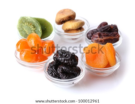 Dried fruits in bowls isolated on white - stock photo